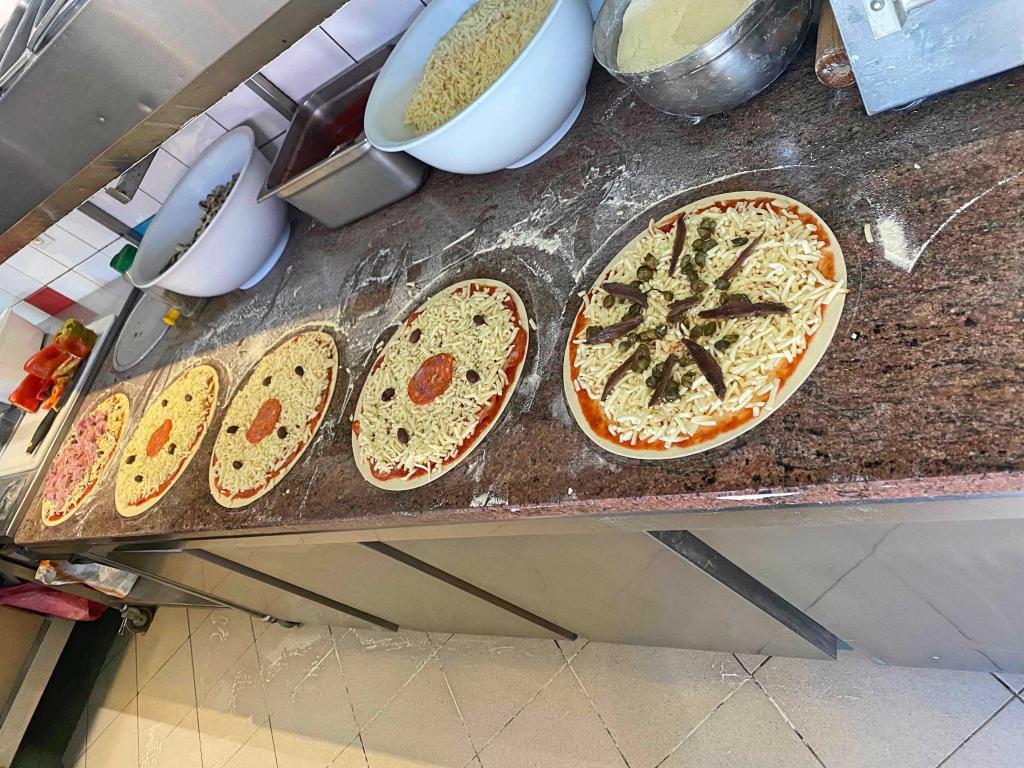 Fabrication et vente de pizzas à emporter et en livraison jouissant d'une excellente réputation - Restauration Rapide